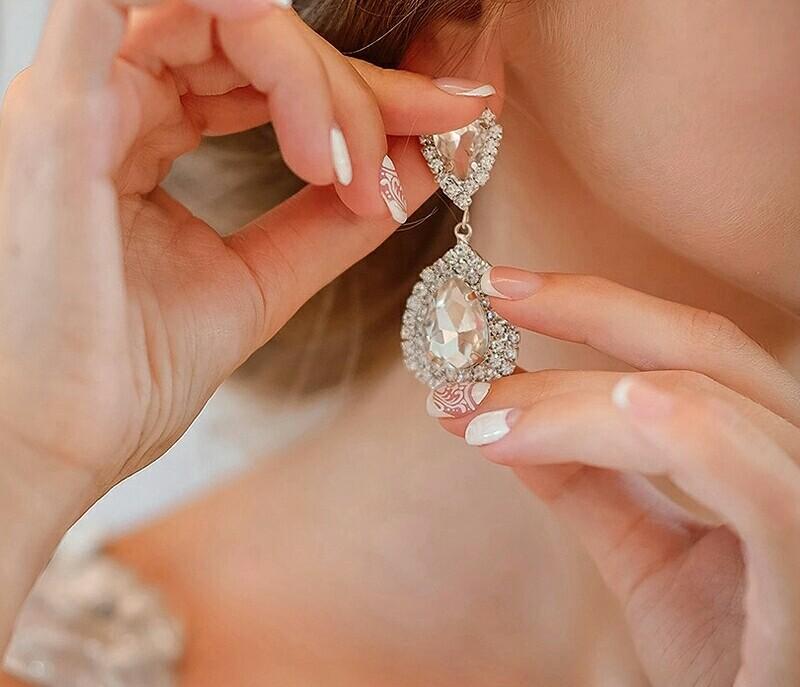 image mariée avec boucle d'oreille