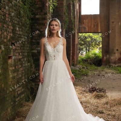 Lace bodice and glitter tulle skirt designer bridal gown 1